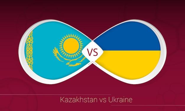 Cazaquistão vs ucrânia em competição de futebol, grupo d. versus ícone no fundo do futebol.