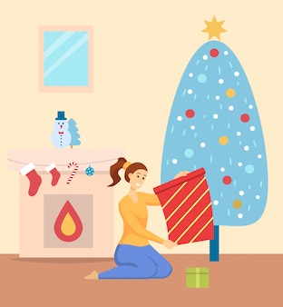 Celebração de natal em casa, mulher com presentes