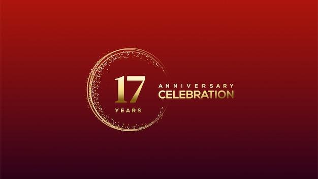 Celebração do 17º aniversário com figuras de ouro sobre fundo vermelho.