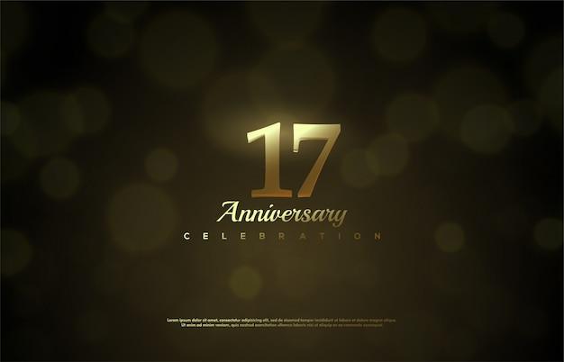 Celebração do 17º aniversário com figuras douradas macias no fundo desfocado.