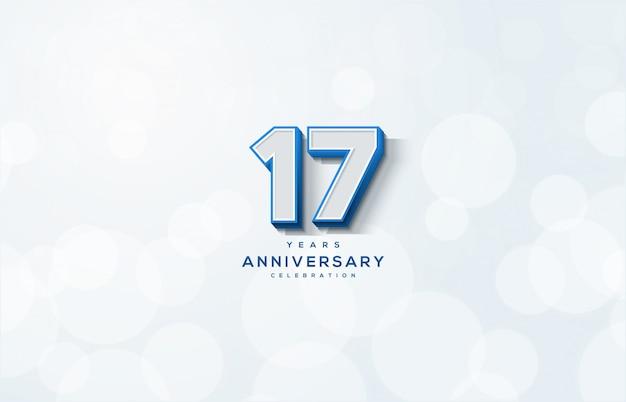 Celebração do 17º aniversário com números brancos e azuis em um fundo branco.