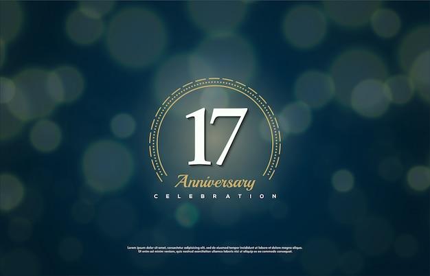 Celebração do 17º aniversário com números com círculos dourados sobre fundo azul escuro.