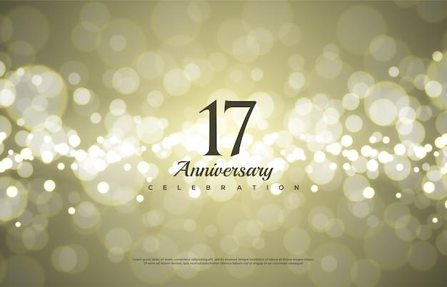 Celebração do 17º aniversário com um fundo dourado bokeh.