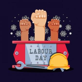 Celebração do dia do trabalho com mãos punho e ferramentas