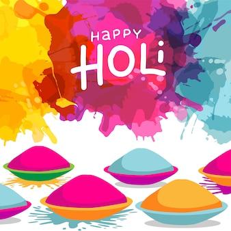 Celebração do festival holi com taças cheias de cores em pó no borrão de respingo colorido. cartão de felicitações