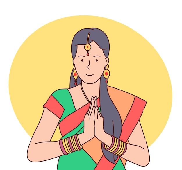 Celebração do festival teej. mulher indiana tradicional de mãos dadas em posição de oração.