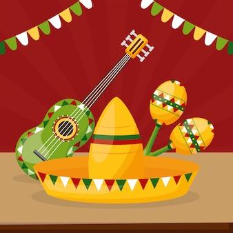 Celebração mexicana com chapéu, violão e maraca em representação da cultura do méxico