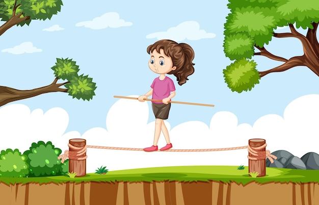 Cena ao ar livre com uma garota se equilibrando na corda