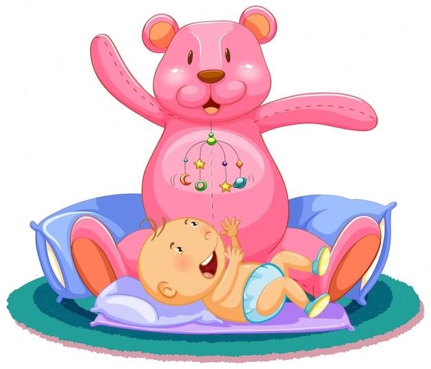 Cena com bebê dormindo na cama com ursinho gigante