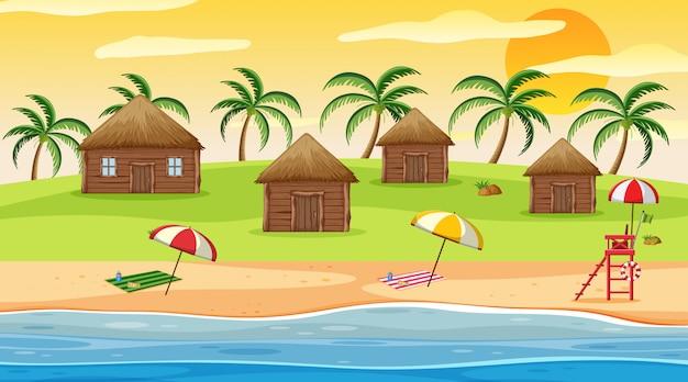 Cena com casas de madeira na praia ao pôr do sol