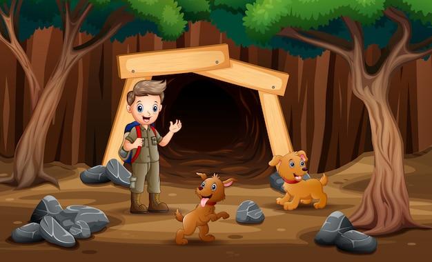 Cena com crianças escoteiras, caminhadas na mina com cães