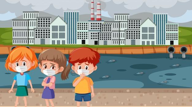 Cena com crianças vestindo máscara na frente da fábrica e água suja
