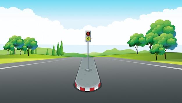Cena com estrada vazia e semáforo