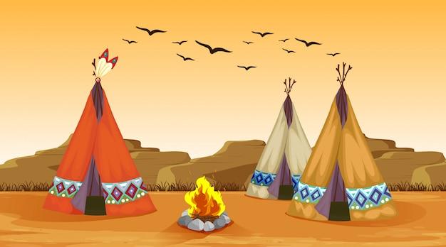 Cena com fogueira e tendas no deserto