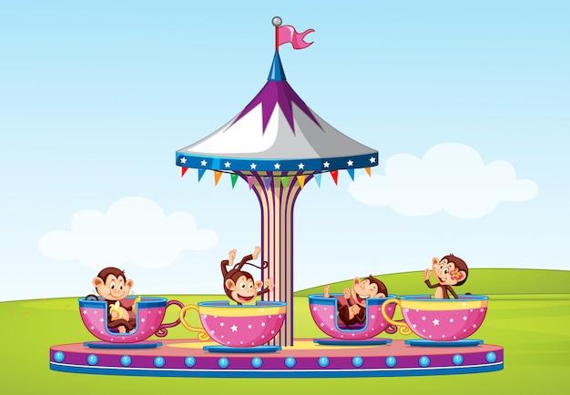 Cena com macacos andando em copo grande no parque
