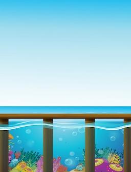 Cena com mar azul e fundo debaixo d'água