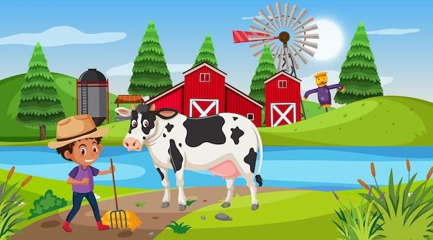 Cena com menino e vaca na fazenda