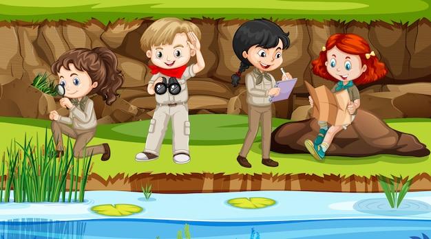 Cena com meninos e meninas explorando a natureza junto ao rio