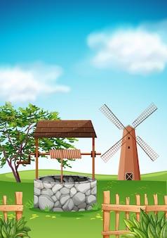 Cena com moinho de vento e bem na fazenda
