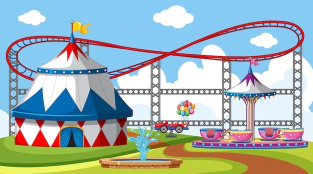 Cena com montanha russa e grande tenda de circo no parque