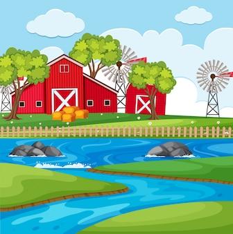 Cena da fazenda com celeiros e rio