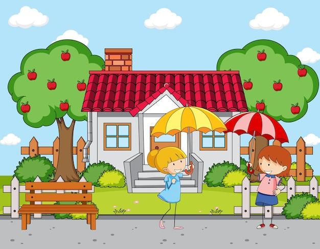 Cena da frente da casa com duas garotas segurando guarda-chuva