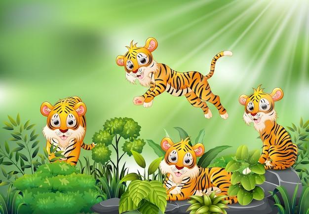 Cena da natureza com um grupo de desenhos animados do tigre