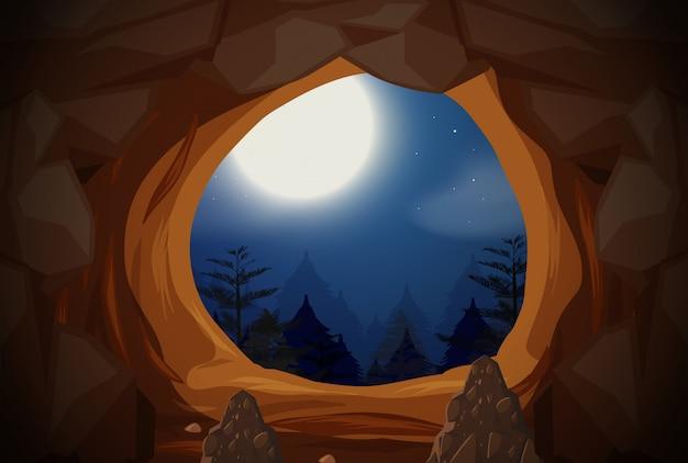 Cena da noite da entrada da caverna