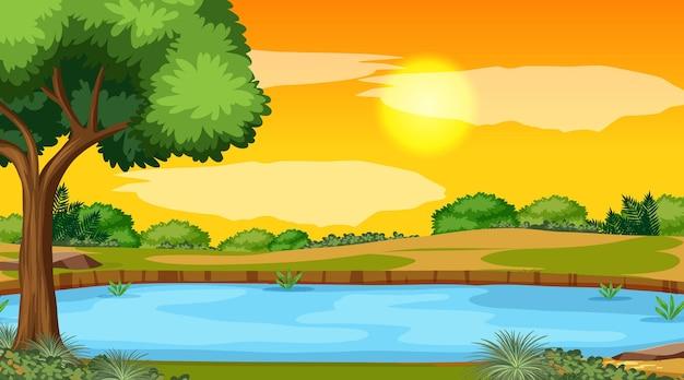 Cena da paisagem da floresta com o rio e o sol se pondo