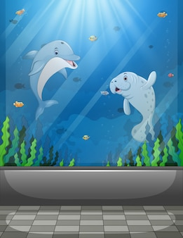 Cena de aquário com animais marinhos nadando