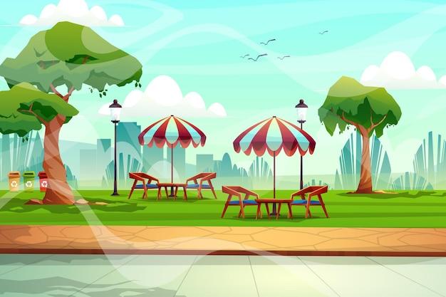 Cena de cadeira com mesa de centro e guarda-chuva perto de gramado verde no parque natural