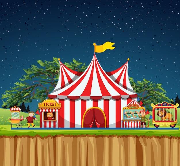 Cena de circo com tenda e leão na gaiola