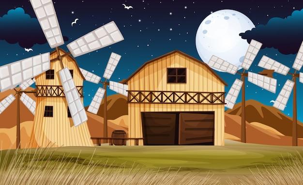 Cena de fazenda com celeiro e moinho à noite