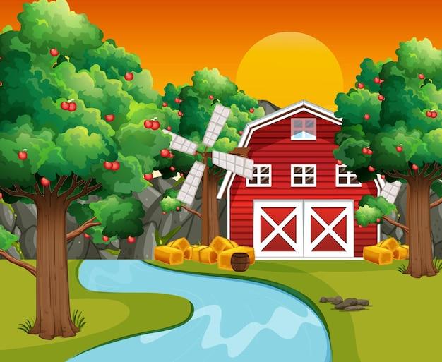 Cena de fazenda com celeiro vermelho e moinho de vento