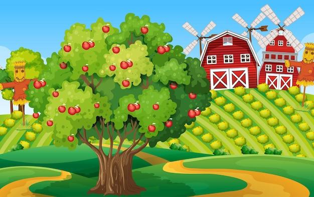 Cena de fazenda com grande macieira e moinho de vento