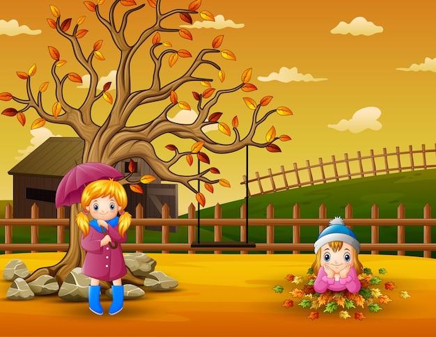 Cena de fazenda com meninas brincando dentro da cerca