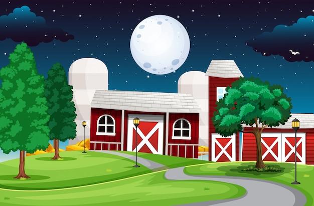 Cena de fazenda de fábrica com lua grande à noite