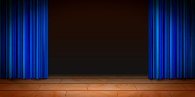 Cena de madeira do teatro com fundo escuro e cortinas azuis