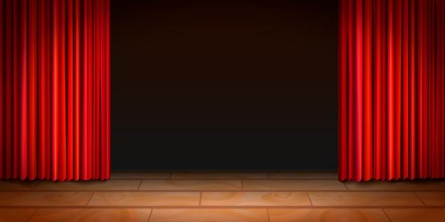 Cena de madeira do teatro com fundo escuro e cortinas vermelhas