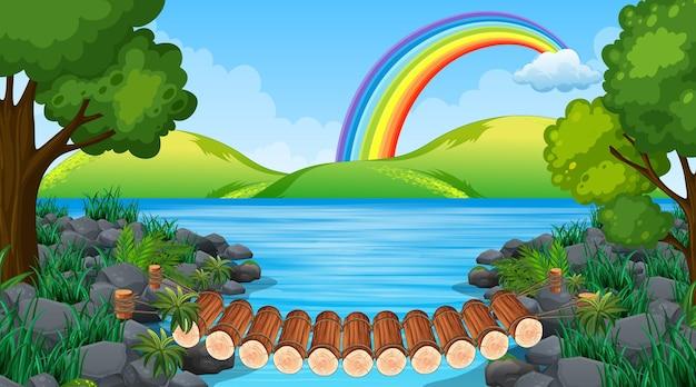 Cena de paisagem de parque natural com ponte sobre o rio e arco-íris no céu