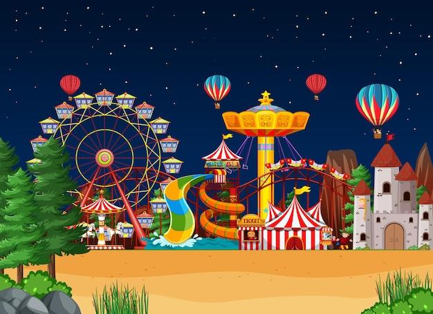 Cena de parque de diversões à noite com balões no céu