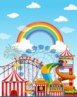 Cena de parque de diversões durante o dia com arco-íris no céu