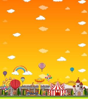 Cena de parque de diversões durante o dia com céu amarelo vazio