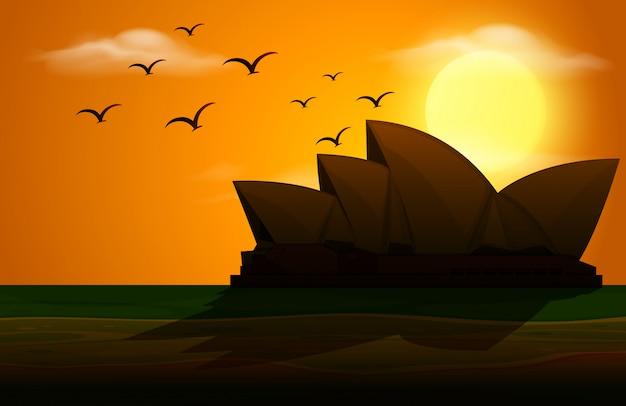 Cena de silhueta com casa de ópera ao pôr do sol