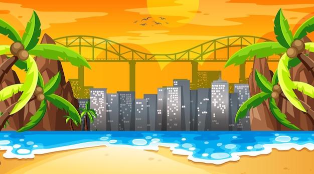 Cena de uma praia tropical na hora do pôr do sol com a paisagem urbana