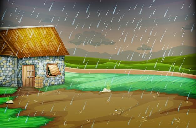 Cena do campo com pequena cabana na chuva