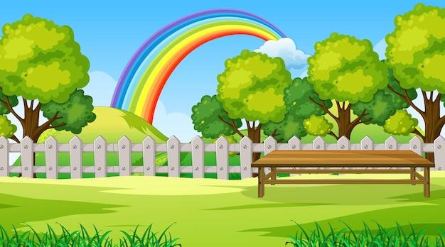 Cena do parque com arco-íris no céu