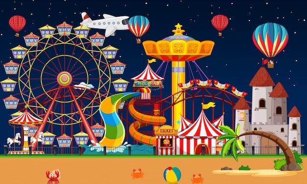 Cena do parque de diversões à noite com balões e avião no céu