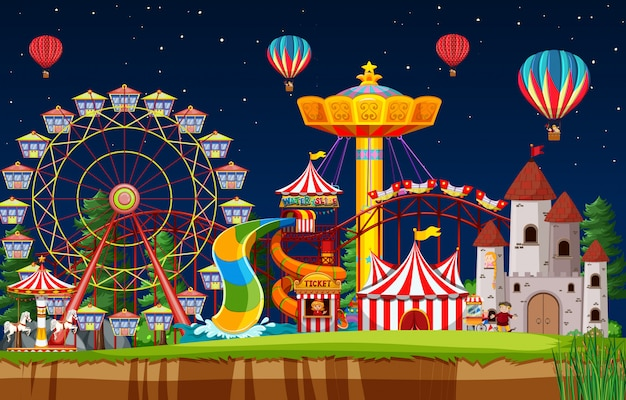 Cena do parque de diversões à noite com balões no céu