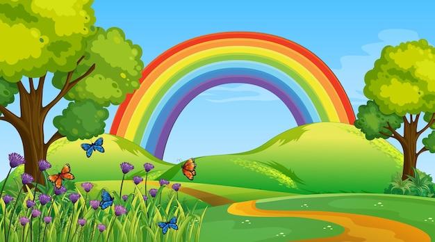 Cena do parque natural com arco-íris no céu
